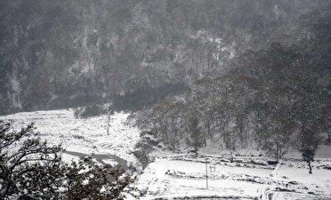 ادامه بارش برف و باران پراکنده و کاهش دما